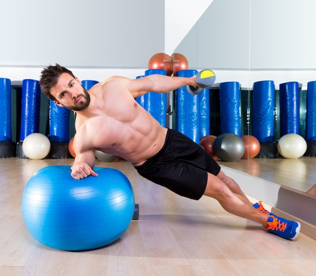 Fitball abdominal side push ups swiss ball man Premium Photo