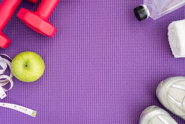 Fitness background with equipment over yoga mat Free Photo
