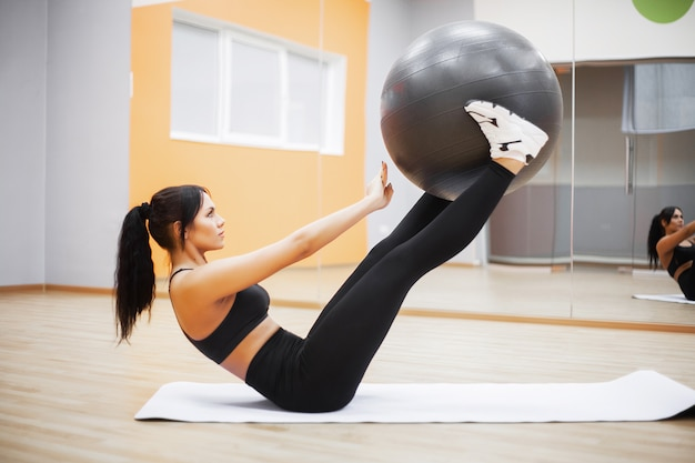 Fitness, beautiful woman smiling face enjoy work out with fit ball in fitness - sport and lifestyle concept. Premium Photo