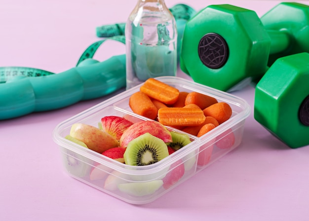 Fitness equipment. healthy food. concept healthy food and sports lifestyle Premium Photo