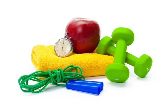 Fitness equipment. healthy food. dumbbells Premium Photo