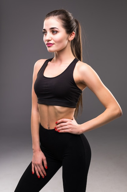 Fitness female woman with muscular body ready for workout