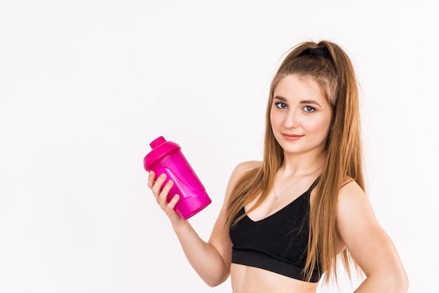 Fitness girl drinking water on white Premium Photo