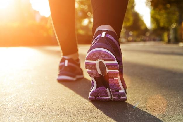 Fitness girl running at sunset Premium Photo