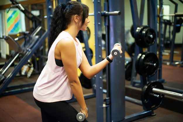 Fitness girl. sexy athletic girl working out in gym. fitness woman doing exercise Premium Photo