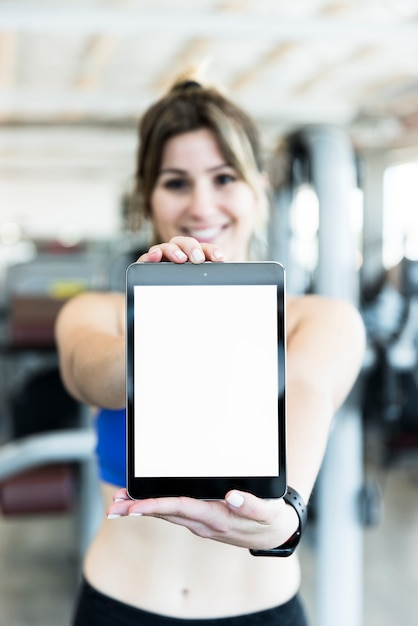 Fitness girl showing tablet Free Photo