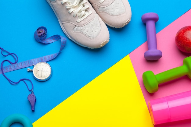 Fitness gym equipment on color background Premium Photo