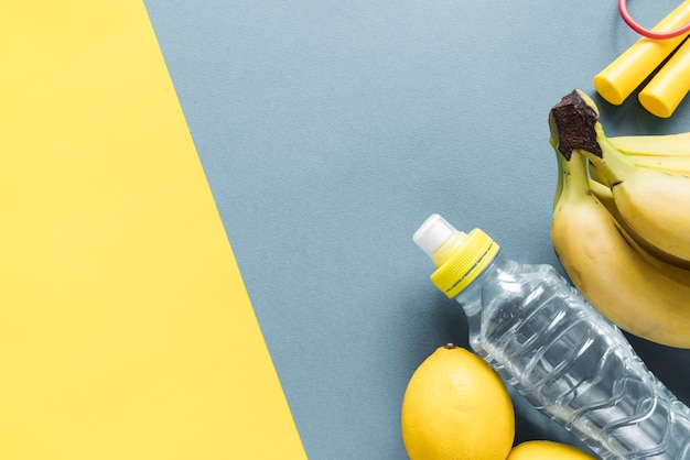 Fitness items on multicolored background Free Photo