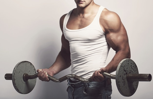 Fitness. man with barbell Free Photo