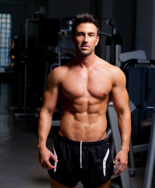 Fitness shaped muscle man posing on gym Premium Photo