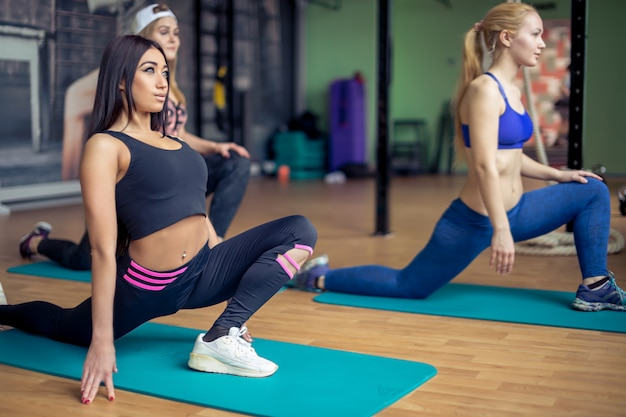 Group Of Young Women Flexing Muscles In Gym Concept Of Sport Fitness Health And Lifestyle Group Of Young Girls Flexing