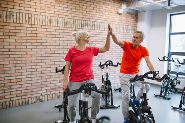 Fitness and teamwork concept with elderly couple Free Photo