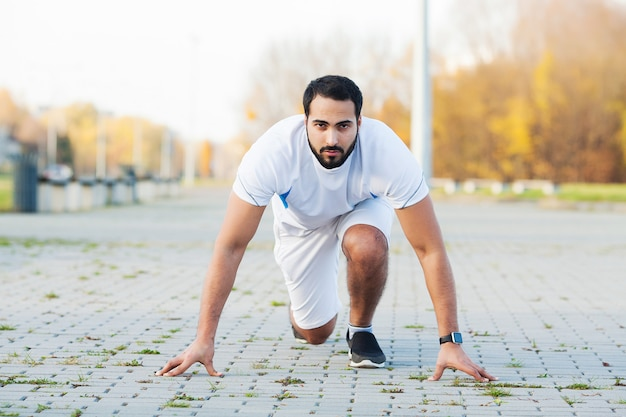 Fitness. tired man runner rest after running on city stree Premium Photo