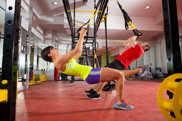 Fitness trx training exercises at gym woman and man Premium Photo