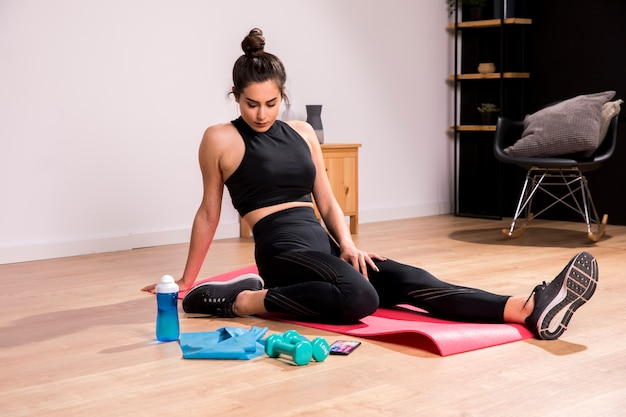 Fitness woman doing exercise at home Free Photo