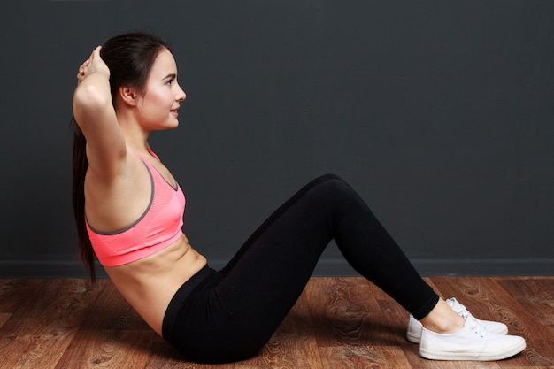 Fitness woman doing exercises for the abs Premium Photo