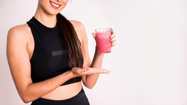 Fitness woman drinking a detox juice Free Photo
