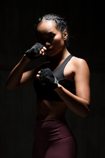 Fitness woman exercise boxing weight punch dark silhouette Premium Photo