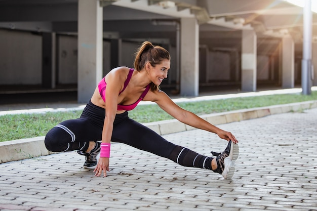 Fitness woman stretching Premium Photo