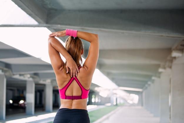 Fitness woman stretching Premium Photo