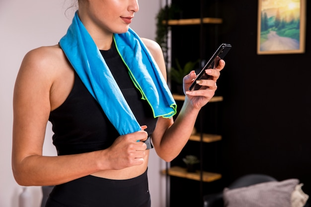 Fitness woman using mobile phone Free Photo