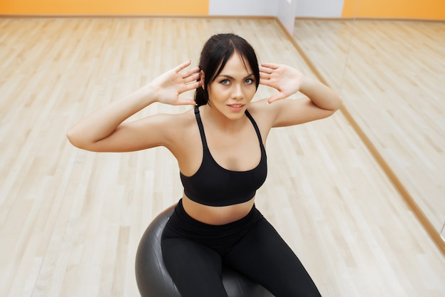 Fitness woman. young attractive woman doing exercises using ball Premium Photo