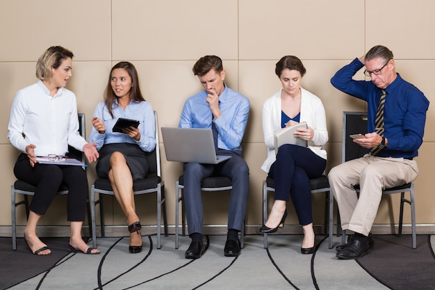 Five Applicants for Corporate Job Sitting in Line Free Photo