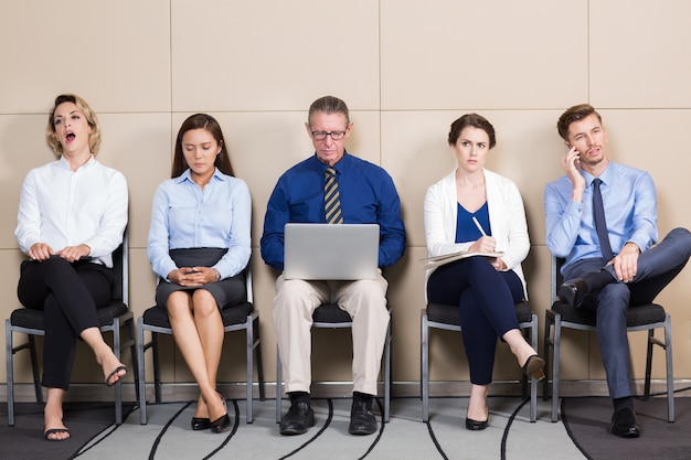 Five business people waiting for job interview Free Photo