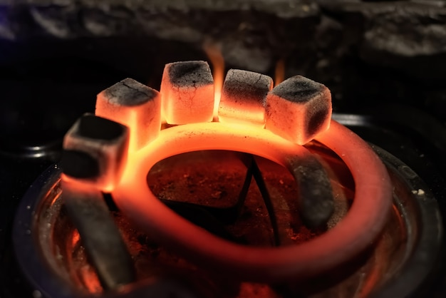 Five coals for hookah heating on the stove Free Photo