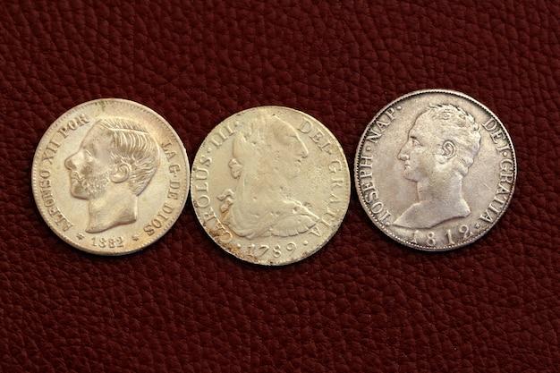 Five pesetas spain old coins alfonso xii carlos iii Premium Photo