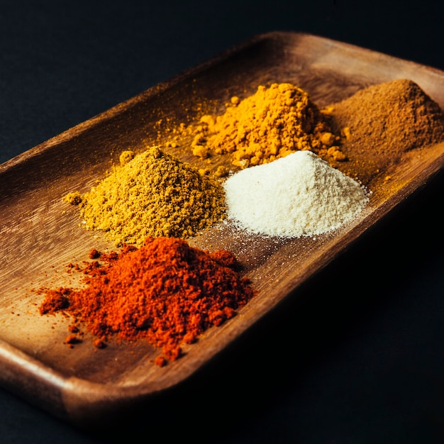 Five spices on board decoration Free Photo