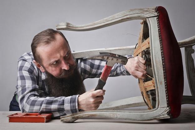 Fixing a chair Premium Photo
