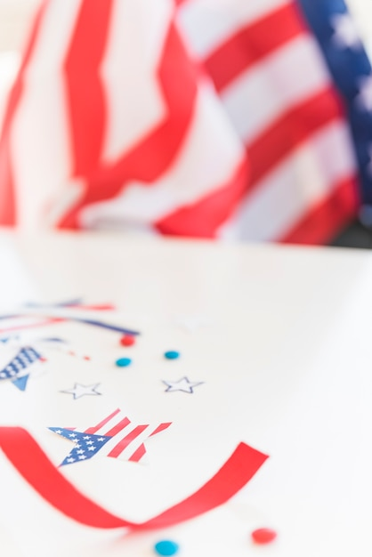 Flag decorative elements on blurred surface Free Photo
