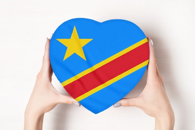 Flag democratic republic of the congo on a heart shaped box in a female hands Premium Photo