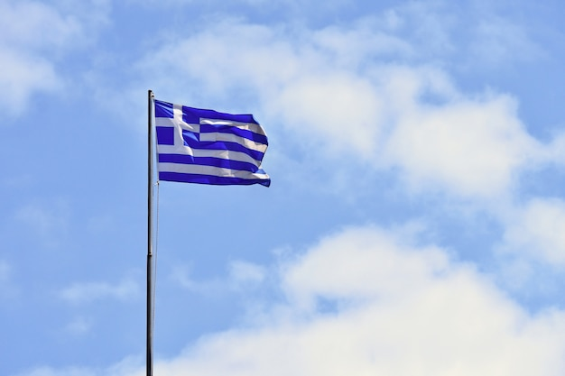 Flag of greece flying in wind and blue sky. summer background for travel and holidays. greece crete. Free Photo