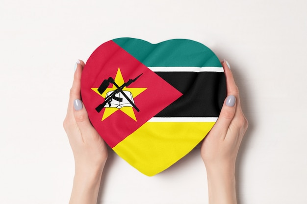 Flag of mozambique on a heart shaped box in a female hands Premium Photo