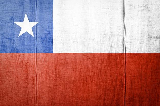 Флаг на фоне текстуры ткани. Premium Фотографии