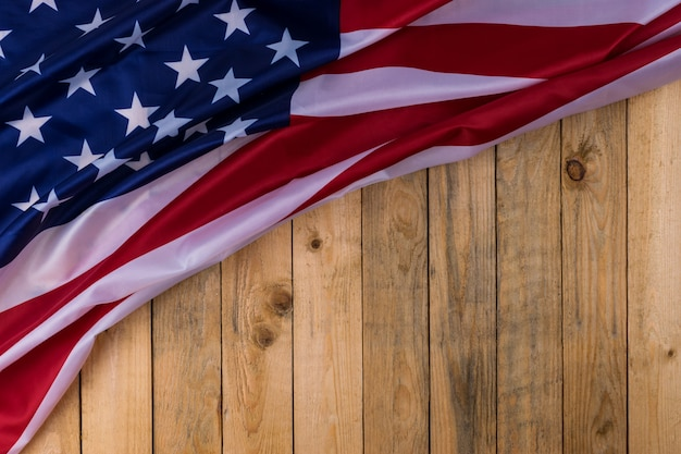 Flag of the united states of america on wooden background. usa holiday of veterans, memorial, independence and labor day. Premium Photo
