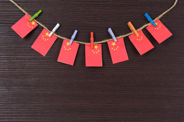 Flags of china on clothesline attached with wooden clothespins Premium Photo