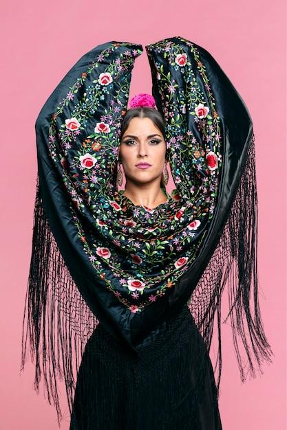 Flamenca dancer with manila shawl looking at camera Free Photo