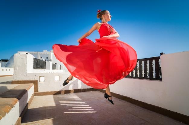 Flamenco dancer leaping Free Photo