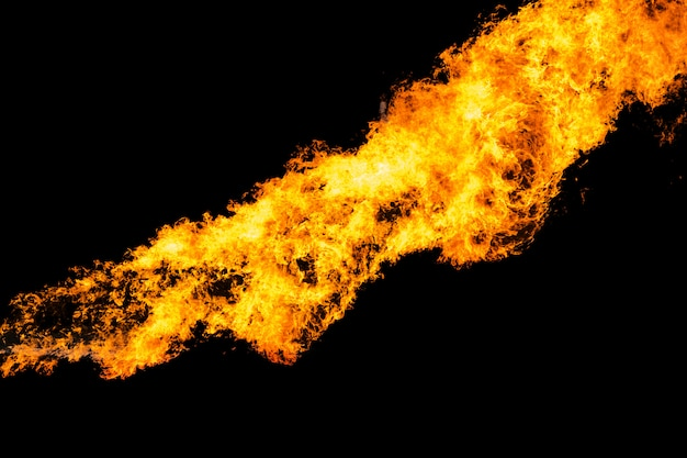 Flames caused by the explosion of the oil isolated on black . Premium Photo