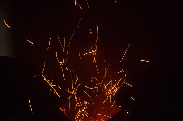 The flames of darkness float in the air.fire charcoal. Premium Photo