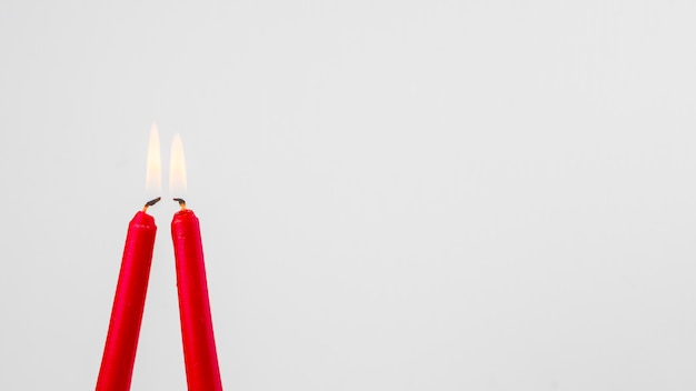 Flaming red candles Free Photo