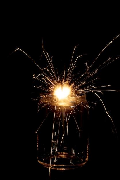 Flaming sparkler in jar Free Photo