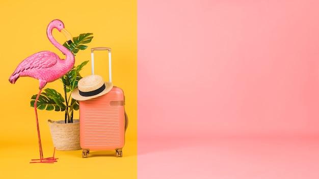 Flamingo, houseplant and suitcase on multicolor background Free Photo