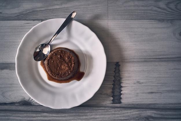 Flan dessert on a dark natural wooden table Premium Photo