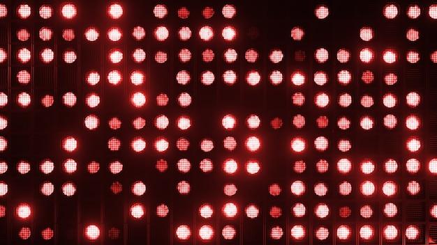 깜박이는 벽 조명. 번쩍이는 불빛 클럽과 디스코를위한 손전등. 매트릭스 빔 헤드 라이트. 나이트 클럽 할로겐 램프. 프리미엄 사진