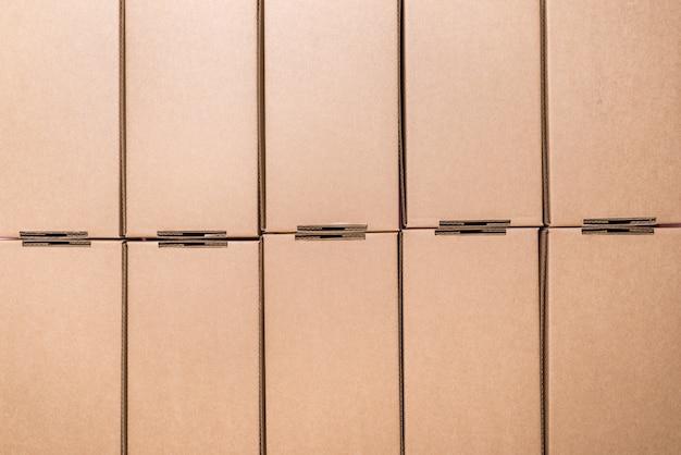 Flat cardboard boxes, textured background Premium Photo