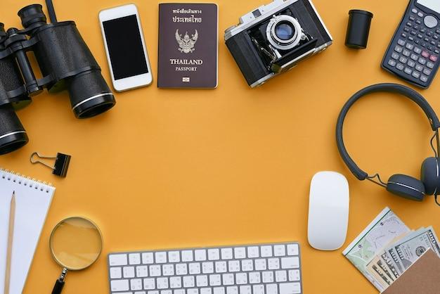 Flat lay of accessories on orange desk Premium Photo